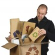 Man recycling cardboard — Stock Photo