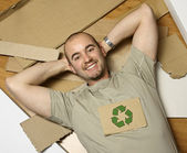Caucasian man and recycling paper — Foto de Stock
