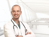 Modern hospital and doctor — Stock Photo