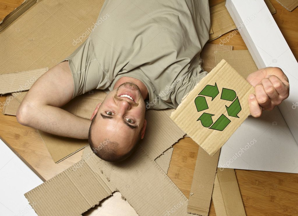Man on wood floor hold  recycling symbol on cardboard  Stock Photo #1203959