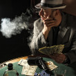 Stock Photo: Gangster smoking and play poker