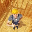 Construction site and handyman — Stock Photo