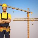 Handyman and construction metal crane — Stock Photo