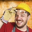 Handyman with protection glass — Stock Photo
