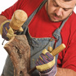 Man and sculpture making - Stockfoto
