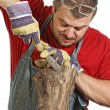 Man sculptor and his wood — Stock Photo