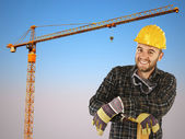 Manual worker with crane background — Stock Photo