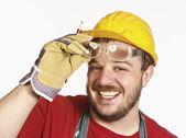 Handyman with protection glass — Stock Photo