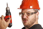 Handyman has fun with drill — Stock Photo