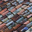 Old roof tile - Stock Photo