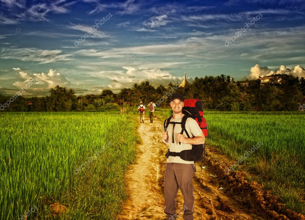 Man standing  on a dusty road in the middle of the rice field — Stock Photo #1743645
