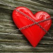 Red heart and metal chain - Stock Photo