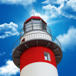 Lighthouse and blue sky - Stock Photo