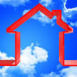 Red house in the sky — Stock Photo