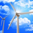 Wind turbine and blue sky - Stock Photo
