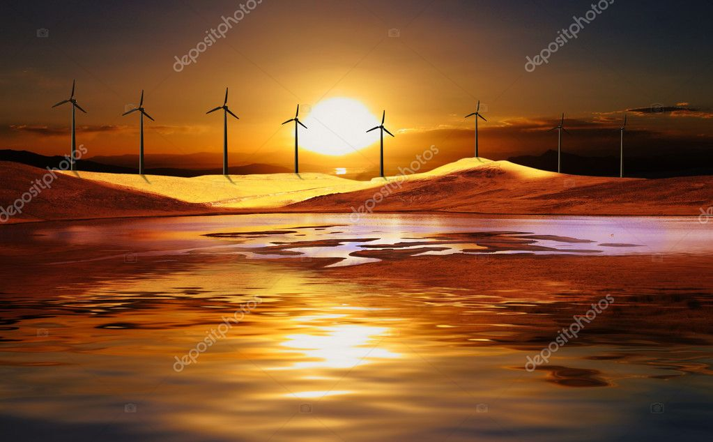 Wind turbine at sunset in a desert with water reflection — Stock Photo #2291431