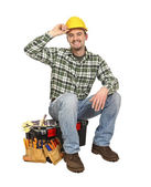 Happy worker on toolbox — Stock Photo