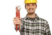 счастливый работник с красной гаечный ключ — Стоковое фото