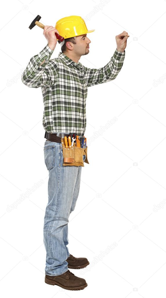 Young manual worker with hammer and nail isolated on white — Stock Photo #2449028