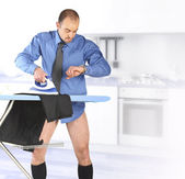 Businessman ironing his trouser — Stock Photo