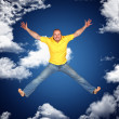 Young man jump and sky — Stock Photo