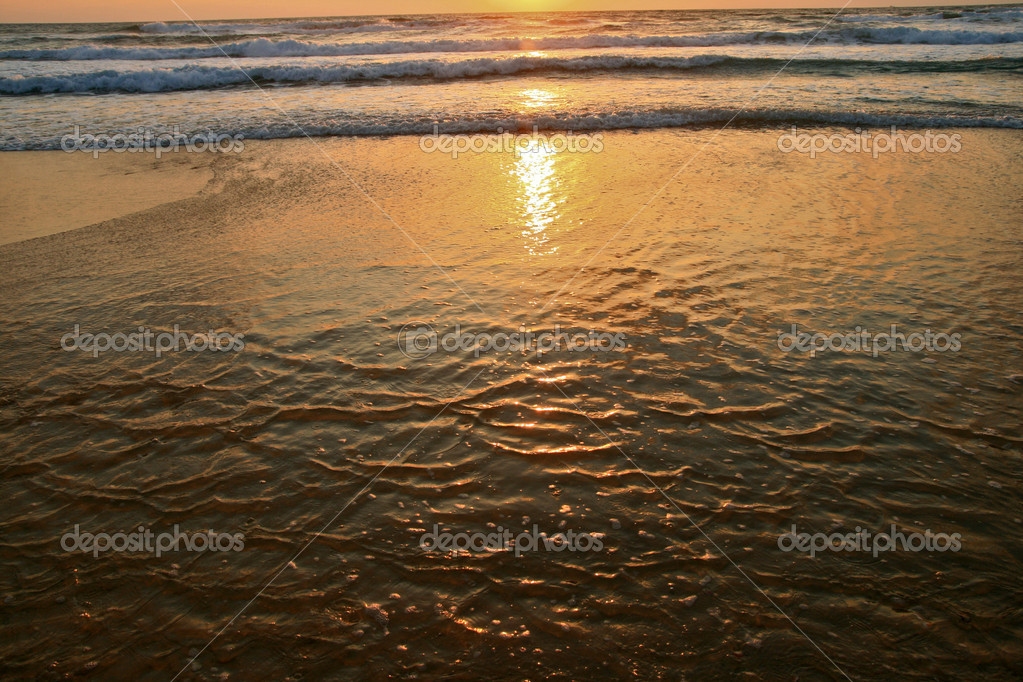 The evening sun in sea water  Stock Photo #1169701