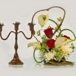 Candlestick and flowers — Stock Photo