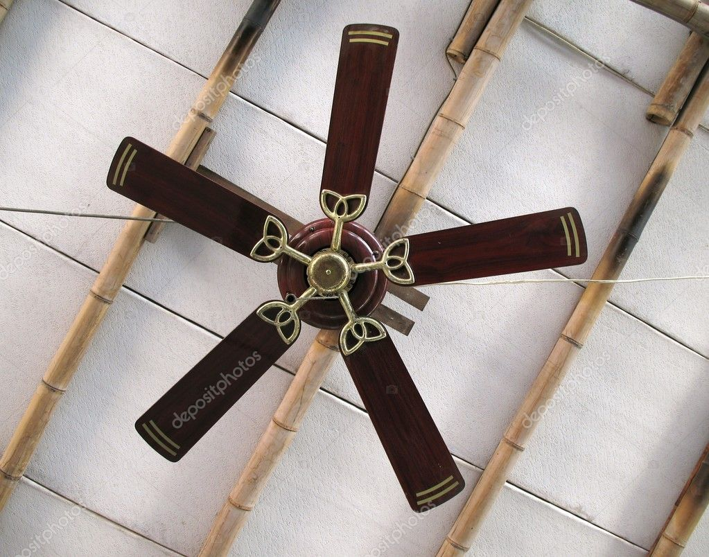 A ceiling fan with five blades on a simple bamboo ceiling — Stock Photo #1079276