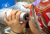 Girl Looking Through Telescope — Stock Photo