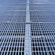Metal grid walkway - Stock Photo