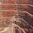 Deep mine hole in rock strata — Stock Photo