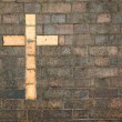 Cross of christ built into a brick wall — Stock Photo #1197592