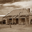 Old farmhouse ruins in sepia — Stock Photo