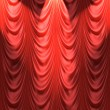 Spotlight on red curtain — Stock Photo