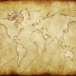 Stock Photo: Old grungy world map on paper