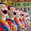 Row of clowns - Stock Photo