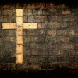 Cross of christ built into a brick wall - Stock Photo