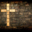 Cross of christ built into a brick wall — Stock Photo