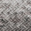 Stock Photo: Rough black diamond plate