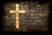 Cross of christ built into a brick wall — ストック写真