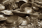 Gold pans in sepia — Stock Photo