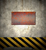 Old hazard wall with plaque — Stock Photo