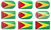 Nine glass buttons of the Flag of Guyana — Stock Photo