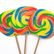 Three lollipops on white background - Stock Photo