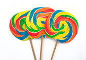 Three lollipops on white background — Stock Photo
