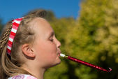 Girl with blower — Stock Photo