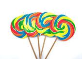 Four lollipops on white background — Stock Photo