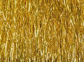 Golden tinsel texture — Stock Photo