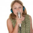 Young girl singing isolated on white — Stock Photo