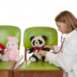 Girl playing doctor with her toys — Stock Photo #1972975